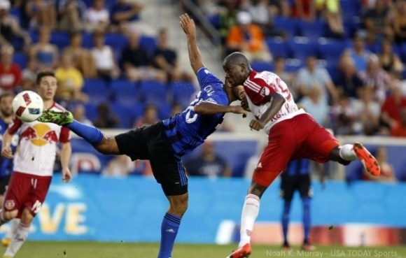 Aug 13, 2016; Harrison, NJ, USA;   New York Red Bulls forward Bradley Wright-Phillips (99) beats Montreal Impact defender Victor Cabrera (36) for his second goal during the first half at Red Bull Arena. Mandatory Credit: Noah K. Murray-USA TODAY Sports