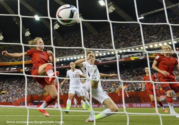 MONTREAL, QC - JUNE 30:  Kelley O'Hara of the United States scores the second goal past Tabea Kemme of Germany in the FIFA Women's World Cup 2015 Semi-Final Match at Olympic Stadium on June 30, 2015 in Montreal, Canada.  (Photo by Dennis Grombkowski/Bongarts/Getty Images)